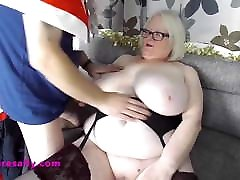 Mature Sally enjoying a big tits cum bath
