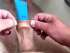 Floppy foreskin in bath with plastic tube