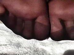 Feet In Black Nylon