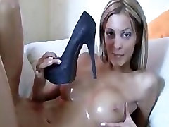 HOT BLONDE FUCKS HERSELF WITH HIGH-HEEL AND TASTES HER CUM ON IT