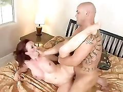 Mature brunette sucks on the cock before she sits on it to fuck