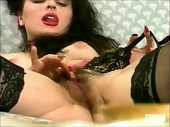 Pretty brunette spreads her pussy