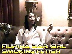 Cute sexy 18 yo asian teen girl creates smoke rings