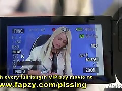 Naughty newsreader and camerawoman pissing on each other