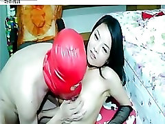 Asian Man in Red Mask Plays with Hot Asian