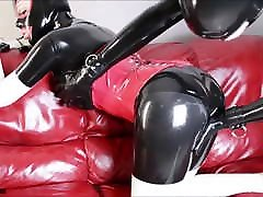 Latex Couple andrea seksa on Red Leather Couch