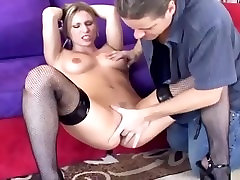 Blonde babe Harmony fucked on a couch in stockings and black high heels
