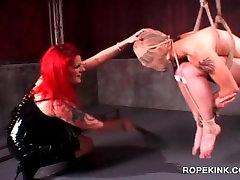 BDSM dominatrix torturing her male slave