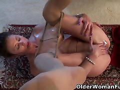 Mature Mimi uses massage oil on her pussy in nylons