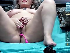 Big ass woman caresses her pussy