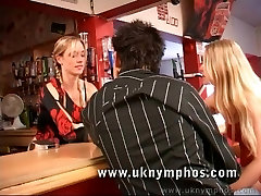 English girls have threesome in a bar