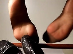 heelpopping and dangling chinese tits push pantyhose feet under the chair