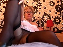 Busty mature babe in eye fuck tube stockings and slip