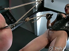 BDSM XXX bollynation videos boy in straight jacket and anal hook swings brick from his balls to please his Mistress