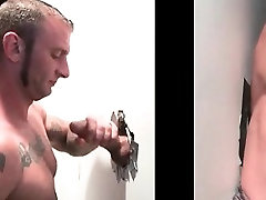 Muscled tattooed gay sucking cock on gloryhole