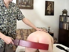 Brunette gets spanked and then bends over to get her ass whacked