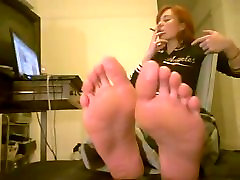 sexy feet posing while girl is smoking