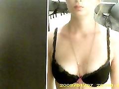 Dressing room hidden cam - Topless brunette with nice boobs