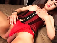 Busty ladyboy in a corset tugging to climax