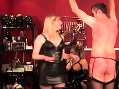 Femdoms mistreating pathetic sub with whip