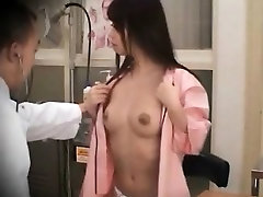 Japanese sweetie getting her ten model boobs checked at the docs