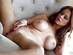 Busty Emily Addison shows her technique to please her pussy