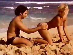 Ginger Lynn rides Ron Jeremy big cock on beach
