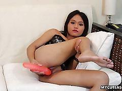 Doll looking Asian cuttie pleasuring her wet cunt