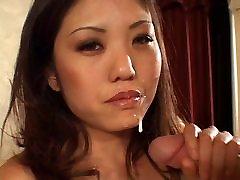 Asian chick giving a handjob