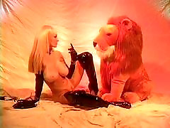 Big tits blonde playing with her stuffed lion