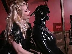 Randy bitch sucking on huge black dildo