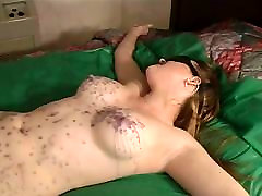 Julie Simone in nylons enjoying hot wax over her body
