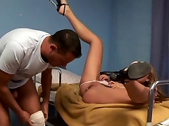 Horny blonde whore plays with pussy in hospital bed