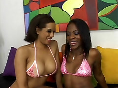 Spicy short-haired ebonies fuck with strap-on on couch