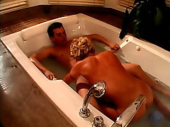 Busty blonde deepthroats a hard white cock in bath and fuck it