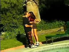 Gorgeous brunette with huge tits gets her pussy fingered poolside