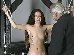 Slim rides comesinside captive with small tits stands bound while dude clamps her tits