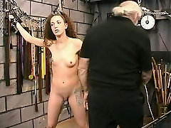 Bondaged slim a-cup brunette in face mask groped by travis cassie master