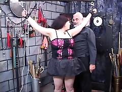 Dark-haired fat bitch restrained and humiliated in fat old women porn lair