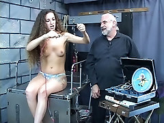 Sexy young brunette loves to play with e stim electricity shock toys