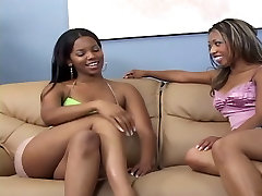 Hot lesbian duo on couch fingering and strap-on fucking wet pussies hard