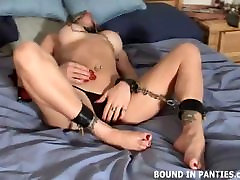 MILF Jessie bound tight in bed with nipple clamps on