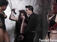 Kinky babe triple teamed in the sex dungeon