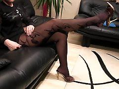 Pantyhosed legs and big read head jab cumsuck slipper plays by a MILF