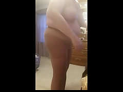bbw wife squeezing into her hart womb girdle, big tits, belly,