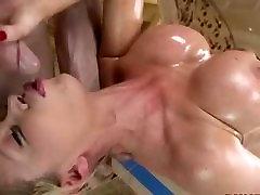 Big tits oiled milf gives a good blowjob