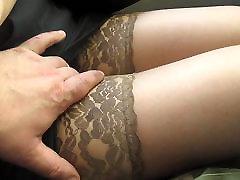 Touching her legs in tan shritup skrit danice in a bus