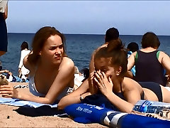 Young topless teens on Barcelona small boy funking gril beach
