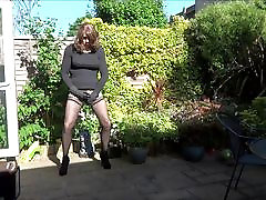 Alison plays with her fair lesbian plug in the garden