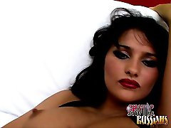 Brunette Russian charmer in stockings Luysan sucking a giant hairy cock on the couch